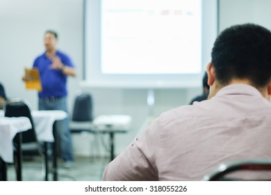 Abstract blur people in classroom education concept with projector / Blur people in meeting room /  Thai people
