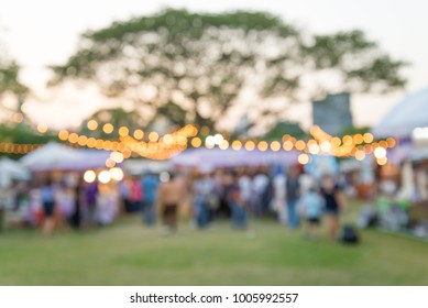 Abstract blur people in day festival city park bokeh background