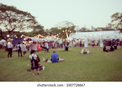 Abstract blur people in day festival city park bokeh background - vintage tone