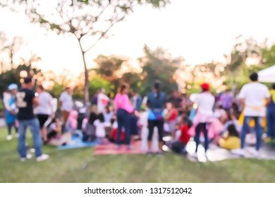 Abstract blur people do activity or picnic in public park with family or friends, urban leisure lifestyle concept, happy holiday recreation vacation in weekend
