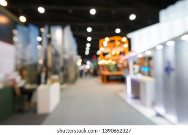 Abstract blur people in exhibition hall event trade show expo background. Large international exhibition, convention center, MICE industry business concept