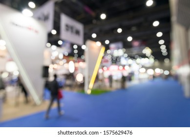 Abstract blur people in exhibition hall event trade show expo background. Large international exhibition, convention center, MICE business industry concept