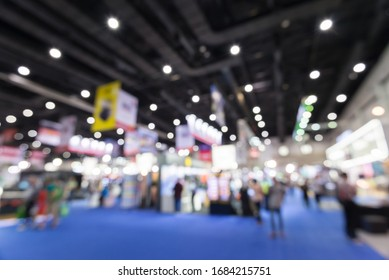 Abstract blur people in exhibition hall event trade show expo background. Large international exhibition, convention center, Business marketing and MICE industry concept.
