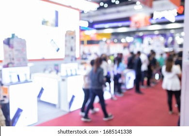 Abstract blur people in exhibition hall event trade show expo background. Business convention show, job fair, or stock market. Organization or company event, commercial trading, or shopping mall