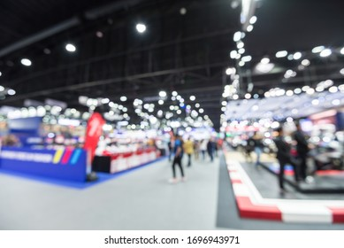Abstract blur people in exhibition hall event trade show expo background. Large international exhibition, convention center, Business marketing and MICE industry business concept.