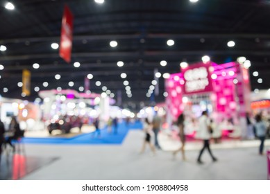 Abstract blur people in exhibition hall event trade show expo background. Large international exhibition, convention center, business marketing and event fair organizer concept.