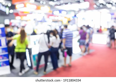 Abstract blur people in exhibition hall event trade show expo background. Business convention show, job fair.