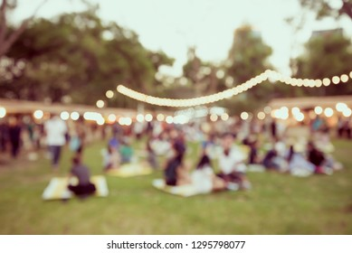 Abstract blur people in festival city park bokeh background. Summer festival holiday or celebration party concept - Retro filter effect