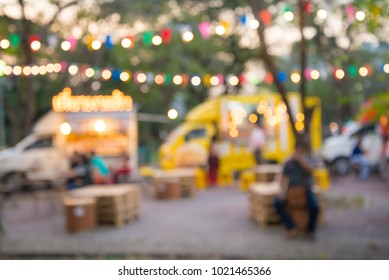 Abstract blur people in food and drink truck night festival city park bokeh background