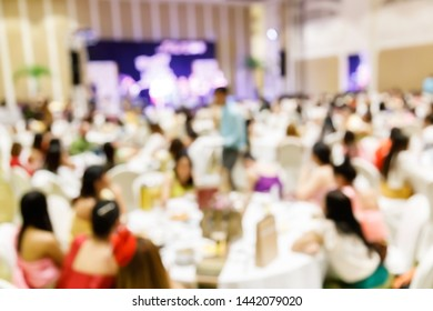 Abstract blur people in gala dinner party, happy celebration in ballroom banquet catering lifestyle concept, eating buffet, cocktail modern restaurant