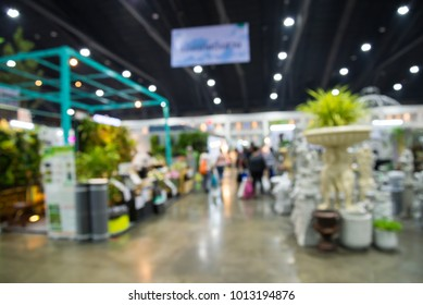Abstract blur people in home and gardening market fair event background