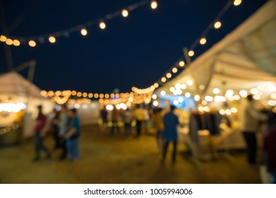 Abstract blur people in night festival city park bokeh background - vintage festival outdoor market