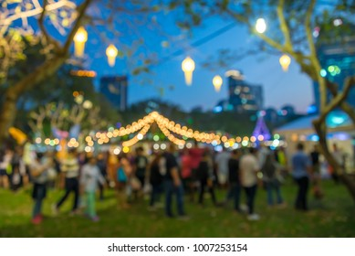 Abstract blur people in night festival city park bokeh background