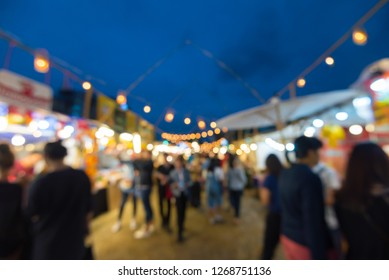 Abstract blur people in night festival bokeh background - vintage outdoor market festival