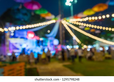 Abstract blur people in night festival city park bokeh background. Summer festival holiday or celebration party concept.