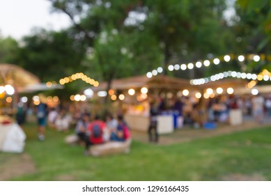 Abstract blur people in night festival city park bokeh background. Summer festival holiday or celebration party concept