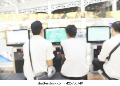 Abstract blur of people playing a computer football games