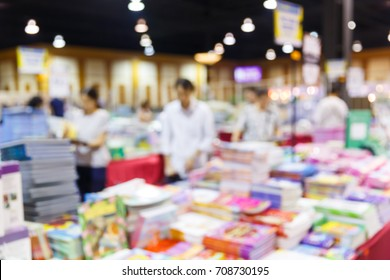 Abstract blur people shopping book in clearance discount sales exhibition fair