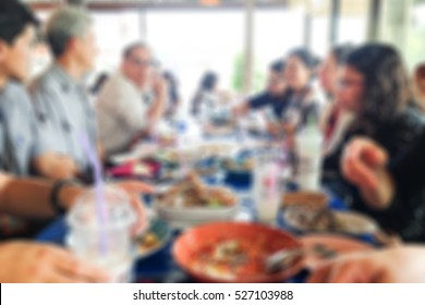 Abstract Blur People Sitting Together On Table For Lunch In Outdoor  Restaurant For Background Usage