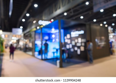 Abstract blur people in trade show expo background