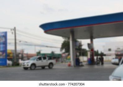 Abstract blur of Petrol station for fuel the car And motorcycle for background.
