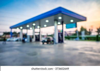 Abstract blur photo of car refueling on gas station at sunset. Pump gasoline gauge oil in the evening. This photo can be used for automotive service industry or unleaded transportation concept