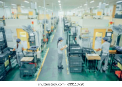 Abstract blur photo of Supervisors are checking work in production lines
