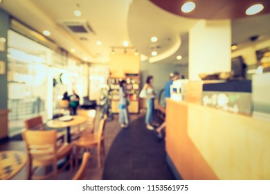 Abstract blur restaurant and coffee shop cafe interior for background