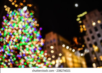 An abstract blur of the Rockefeller Center Christmas Tree and surrounding buildings.