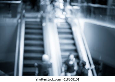 Abstract blur shopping mall interior and retail store for background in blue color