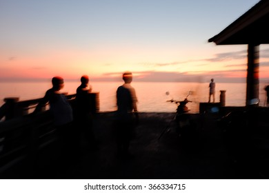 Abstract Blur silhouette of man fishing rod sunset background