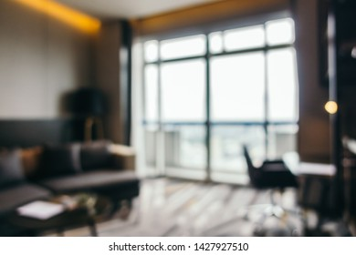 Abstract blur sofa light lamp and pillow in living room interior for background