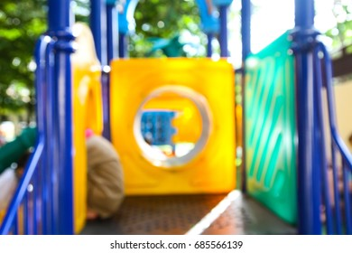 Abstract blur students playing at a playground kid zone in a school.