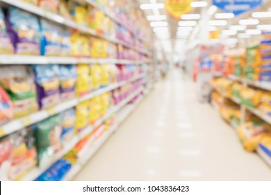 Abstract blur supermarket discount store aisle and pet food product shelves interior defocused background