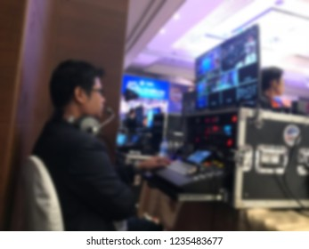 abstract blur of Technicians are controlling video production