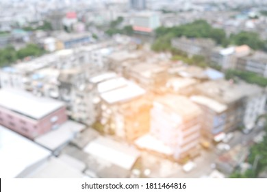 Abstract blur. Top view of a tall building in a beautiful city in the morning sun.
