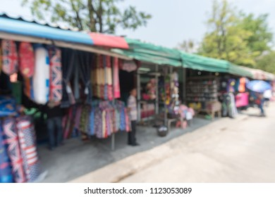 Abstract blur tourist shopping in  weekend market outdoor in sunny day