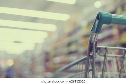 abstract blur of trolley in supermarket shopping mall:blurry background picture.