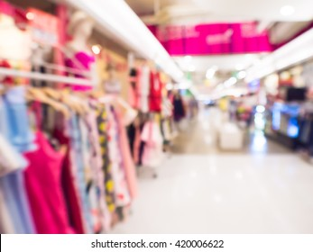 abstract blur vintage style clothing store displaying woman's fashion in the mall super center.