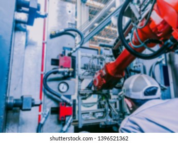 abstract blur with web banner technology and industry 4.0 revolution  concept from technician during setup and use high precision robotic system control injection machine