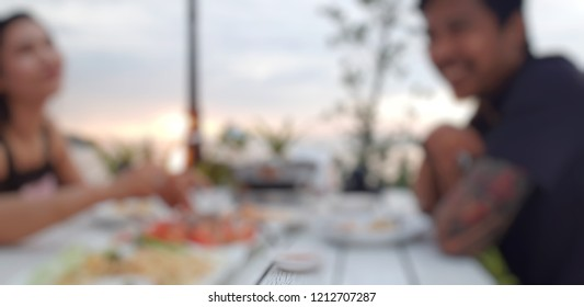 Abstract blurd photo of happy young couple in love in holiday time