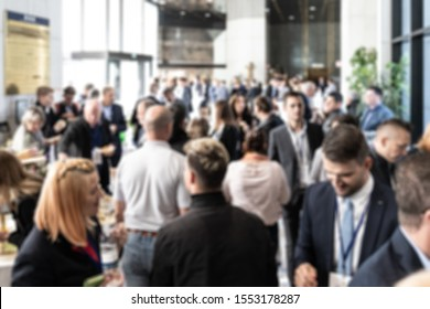 Abstract blured photo of business people socializing during banquet lunch break break at business meetin, conference or event. Business and Entrepreneurship.