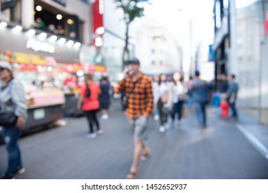 Abstract blurred asian crowd people, tourist group walking and shopping on street market and light bokeh in sunny day can be used for business background, Seoul, Korea, perspective view