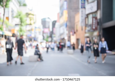 Abstract blurred asian crowd people, tourist group walking and shopping on street market daytime and light bokeh can be used for business background, Seoul, Korea, perspective view