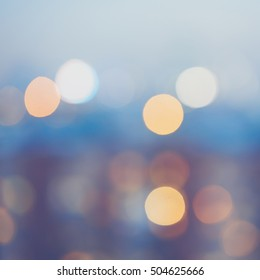 Abstract blurred background with bokeh circles, blue color tint