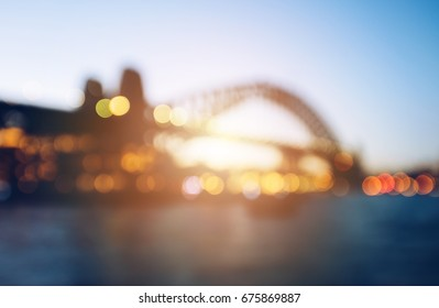 The abstract blurred background (defocus) of Sydney Harbour bridge during the sunset.