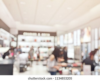 Abstract blurred background of fashion shop. Blur of many people in fashion shop with abstract bokeh light background. Abstract blurred of mid year sale at fashion shop.
