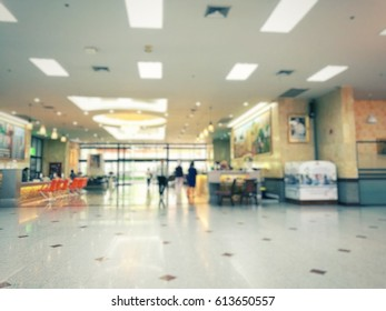 Abstract blurred background front of lobby and customer service in hospital.