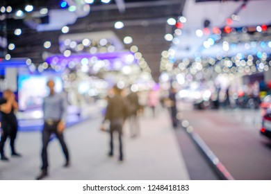 Abstract blurred background image with bokeh light of crowd people at cars exhibition show