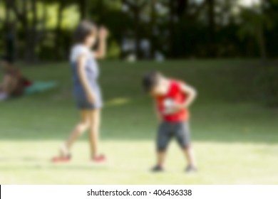 abstract blurred background of kids playing on park